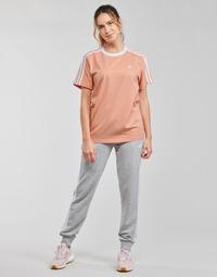 Îmbracaminte Femei Pantaloni de trening adidas Performance WESFTEC Heather / Gri / Moyen